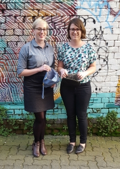 Kirsten and I in our denim garments and with our Ida clutch purses.
